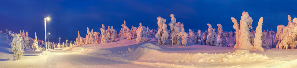 Lighted winter road in Lapland ski resort