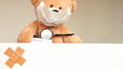 Teddy with mask and stethoscope