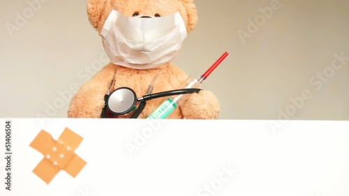 Teddy with mask and syringe
