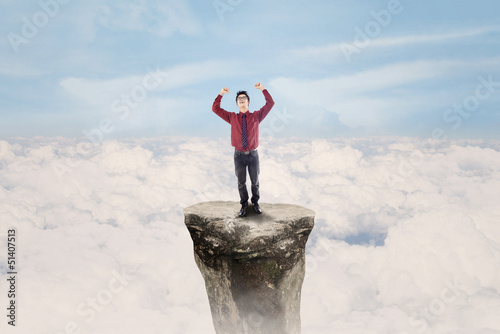 Businessman win above clouds