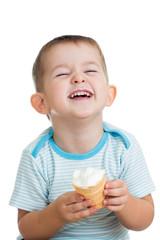 happy kid boy eating ice cream in studio isolated