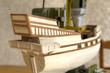 Leinwandbild Motiv Modèle réduit de bateau ancien en cours de construction
