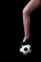long femael leg with a classic soccer ball