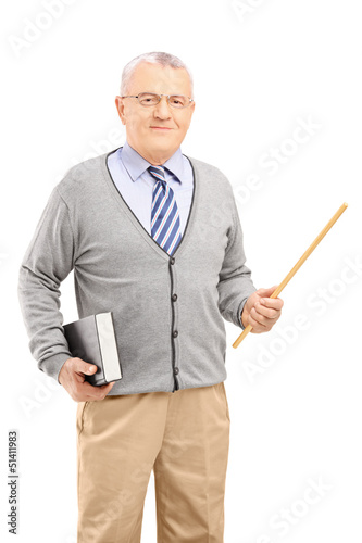 A male teacher holding a wand and a book