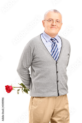 A mature smiling gentleman holding a red rose