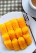 Egg yolk thread (Khanom Foi Tong) served with coffee.
