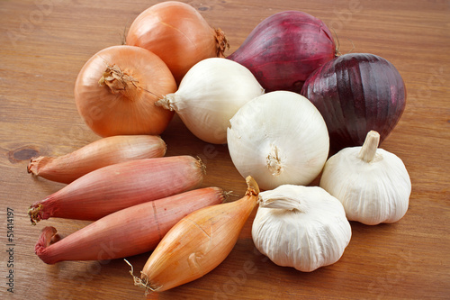 Red, white, yellow and shallot onions with garlic
