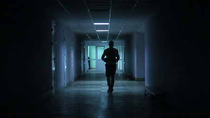 boxer walks down the hall before the fight. Slow motion