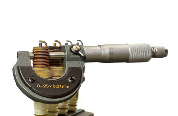 A micrometer and spark plugs