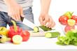 Male cutting cucumber, preparing salad