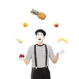 A smiling mime artist juggling fruits