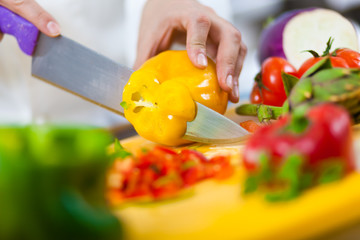 Chef cutting peppers