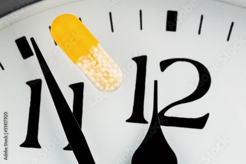 Kapsel auf einer Uhr