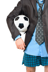 Businessman in his underwear with soccer ball