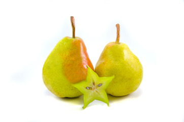 Two yellow pears with carambola