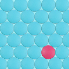 Red pill between blue pills
