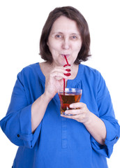 elderly woman drinks juice
