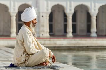 Sikh in a obliteration prayer