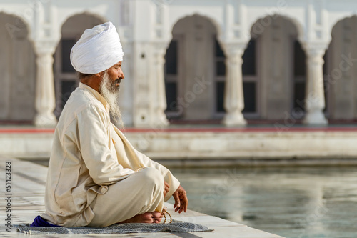 Sikh in a obliteration prayer