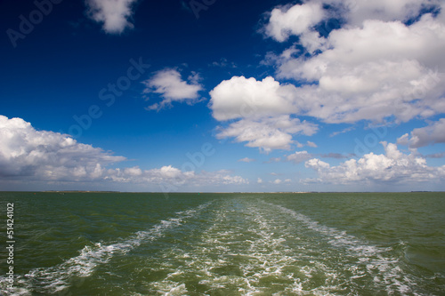 Atlantic sea with spur of boat