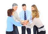 Smiling business people holding hands together