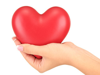 Red heart in woman's hand, on white background close-up