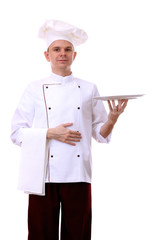 Portrait of chef holding tray on his palm isolated on white