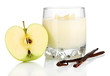 Delicious yogurt in glass with apple isolated on white
