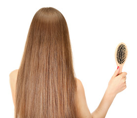 Portrait of beautiful woman with long hair and a hairbrush,