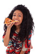 Young black african american teenage girl eating a slice of pizz