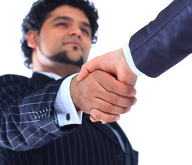 The conclusion of the transaction. Handshake.