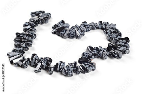 Beautiful necklace, snowflake obsidian nuggets, white background