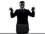 man masked anonymous group member computing computer menacing si