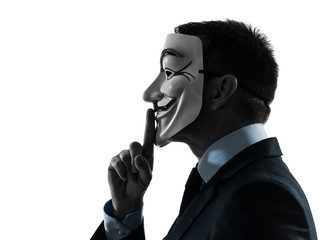 man masked anonymous group member hushing  silhouette portrait