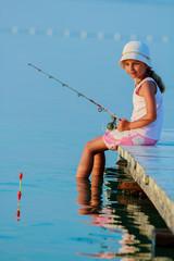 Fishing - lovely girl fishing on the pier