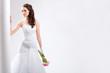 beautiful bride standing near white column