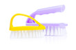 yellow and purple kitchen brushes