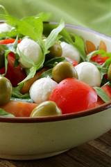 salad with arugula, tomatoes and mozzarella cheese