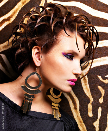 Woman with fashion  hairstyle and glamour makeup