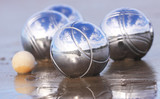 Chrome boules on a sandy beach