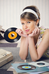 A woman listening to a record
