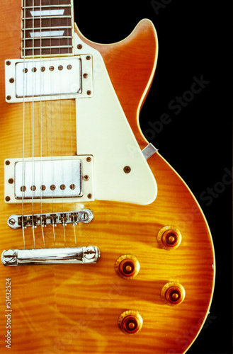 close up of brown Electric guitar