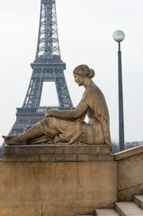 Statue of sitting woman and Eiffel Tower