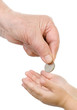 hand of the old person puts a coin in a palm of the child