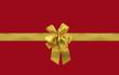 paquet cadeau rouge et ruban doré