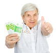 happy old woman with money and thumbs up. isolated