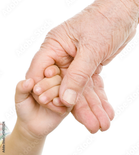 hands of a grandfather and child. isolated on white