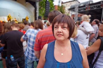 Female visitor of concert of rock-band