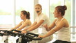 Group of women doing sport spinning in the gym