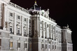 Facade of grandiose and majestic Royal Palace at night in Madrid